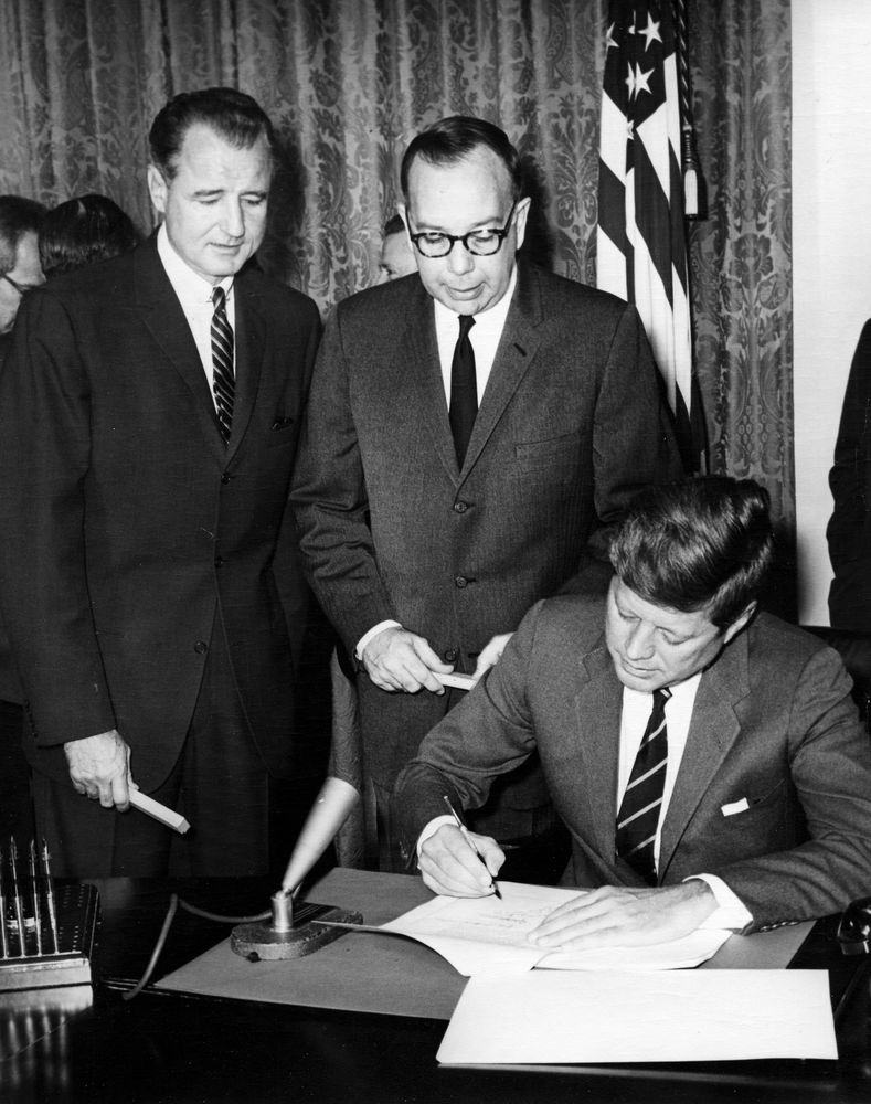 President John F. Kennedy signing the act to authorize UCEDD.