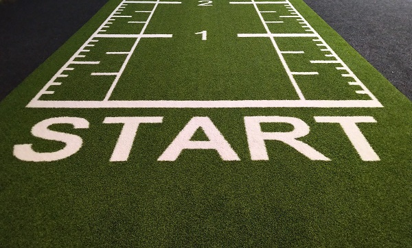 """The word """"Start"""" written at the beginning of a running track"""
